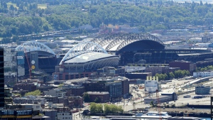 CenturyLink Field, left, home of the NFL football Seattle Seahawks, and T-Mobile Park, right, home of the MLB baseball Seattle Mariners, are shown Wednesday, May 27, 2020, as viewed from the Space Needle. (AP Photo/Ted S. Warren)