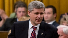 Prime Minister Stephen Harper stands to vote during a non-confidence vote in the House of Commons on Parliament Hill in Ottawa, Ont., Thursday, Oct. 1, 2009. (Sean Kilpatrick / THE CANADIAN PRESS)