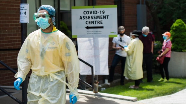 People line up to be tested at a COVID-19 assessment centre in Toronto on Tuesday, May 26, 2020. THE CANADIAN PRESS/Nathan Denette