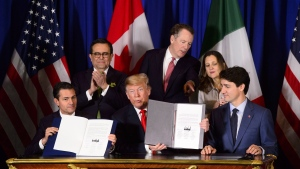 Prime Minister Justin Trudeau, right to left, Foreign Affairs Minister Chrystia Freeland, United States Trade Representative Robert Lighthizer, President of the United States Donald Trump, Mexico's Secretary of Economy Ildefonso Guajardo Villarreal, and President of Mexico Enrique Pena Nieto participate in a signing ceremony for the new United States-Mexico-Canada Agreement in Buenos Aires, Argentina, Friday, Nov. 30, 2018. (THE CANADIAN PRESS/Sean Kilpatrick)