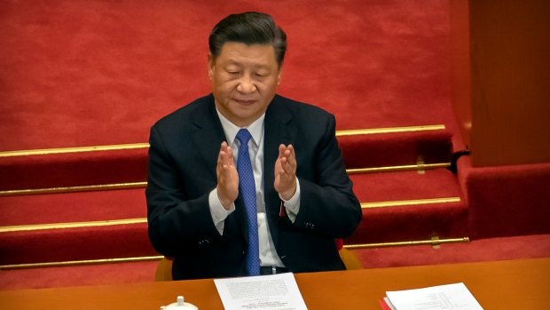 Chinese President Xi Jinping applauds during the closing session of China's National People's Congress (NPC) in Beijing, Thursday, May 28, 2020. (AP Photo/Mark Schiefelbein)