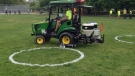 A physical distancing circle is painted onto the grass at Toronto's Trinity Bellwoods Park.
