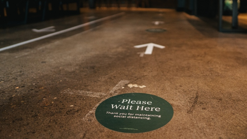 Starbucks stores in Canada will have floor markings, protective barriers and mask-wearing employees as they reopen cafes for walk-in take-out service across Canada. (Photo: Starbucks Canada)