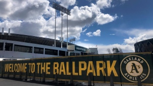 This March 25, 2020, file photo shows a banner to welcome to fans at the Oakland-Alameda County Coliseum in Oakland, Calif. (AP Photo/Ben Margot, File)