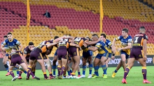 The Parramatta Eels and the Brisbane Broncos of the National Rugby League resume play without spectators, Thursday, May 28, 2020, in Brisbane, Australia. Two rounds of matches were played in the NRL in March before Australia and New Zealand went into lockdown and closed borders in a bid to slow the spread of COVID-19. (Darren England/AAP Image via AP)