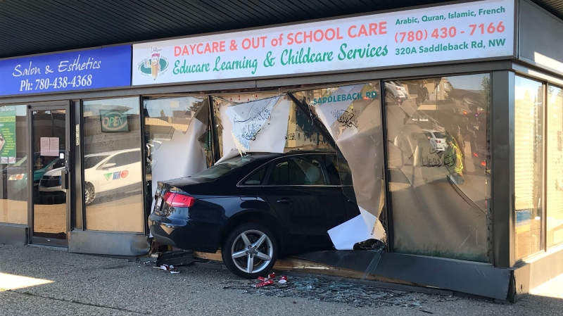 A driver was uninjured after their car went through a window at a southside Edmonton daycare Thursday, May 28, 2020. (CTV News Edmonton)