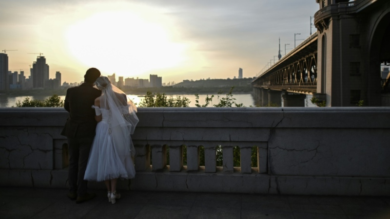 The new 'cooling off' period for divorces in China is one of the top trending topics on China's Twitter-like platform Weibo. (AFP)