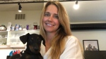 Ashley Payette and her puppy, Hans, are photographed together in her Toronto apartment.
