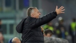 In this Thursday, Nov. 28, 2019 file photo CFR's manager Dan Petrescu gives directions to his players during the Europa League soccer match between Lazio and CFR Cluj at Rome's Olympic stadium. (AP Photo/Alessandra Tarantino, File)
