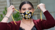 In this Monday, May 18, 2020, photo, Anissa Archuleta wears her mask at her home in Midvale, Utah. (AP Photo/Rick Bowmer)