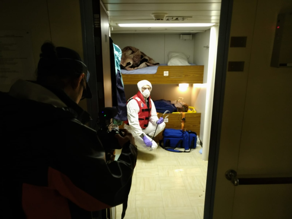 A Canadian Coast Guard member shows what PPE may be used during the pandemic: (Canadian Coast Guard)