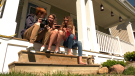 Teens taking part in the Kids Photography Academy sharing photos on their front step
