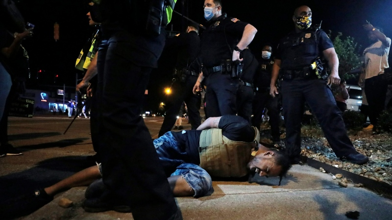 A protestor winces in pain after being pepper sprayed by Memphis police during a protest over the death of George Floyd, Thursday, May 28, 2020, in Memphis, Tenn. (Patrick Lantrip/Daily Memphian via AP)