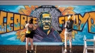 Artists complete a mural of George Floyd outside of Cup Foods, Thursday, May 28, 2020 in Minneapolis/ Minnesotans took to the streets in a third day of protests following the death of George Floyd at the hand of Minneapolis police officers. (Mark Vancleave/Star Tribune via AP)