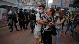 A woman argues with police as she was told to stay away from the area in Mongkok, Hong Kong, Wednesday, May 27, 2020. (AP / Kin Cheung)