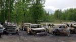OPS Arson Unit investigates fire at LeitrimRoad yard. (Photo: Ottawa Police Service)