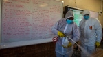 Disinfecting a classroom at Ivory Park Secondary School east of Johannesburg, South Africa, on May 28, 2020. (Themba Hadebe / AP)
