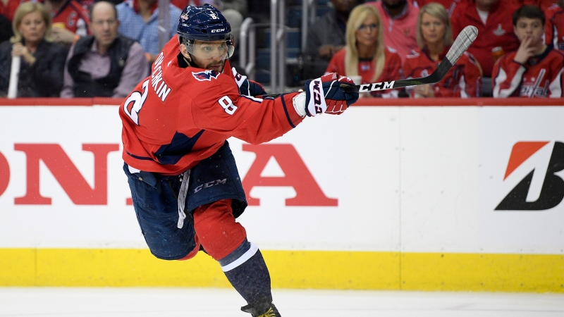 "FILE - In this April 13, 2019, file photo, Washington Capitals left wing Alex Ovechkin (8), of Russia, follows through on a shot during the second period of Game 2 of an NHL hockey first-round playoff series against the Carolina Hurricanes, in Washington. Washington's Alex Ovechkin and Boston's David Pastrnak share the Maurice ""Rocket"" Richard Trophy the league announced Thursday, May 28, 2020. (AP Photo/Nick Wass, File)"