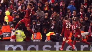 In this file photo taken on March 11, 2020, Liverpool's Roberto Firmino celebrates after scoring his side's second goal during a Champions League soccer match between Liverpool and Atletico Madrid at Anfield stadium in Liverpool, England. (AP Photo/Jon Super)