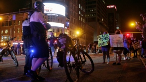Police watch protesters in downtown Columbus, Ohio, on May 28, 2020. (Barbara J. Perenic / The Columbus Dispatch via AP)