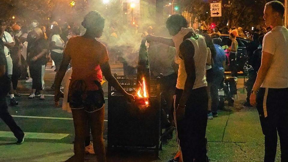 Demonstrators gather in downtown Louisville, Ky.