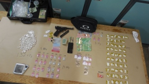 Two kilograms of marijuana derivatives were seized, as well as oxycodone pills, LSD, ecstasy, hallucinogenic mushrooms and seven grams of cocaine. (Photo: RCMP)