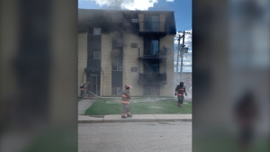 Saskatoon firefighters respond to an apartment fire May 28 on Avenue U South. (Saskatoon Fire Department)