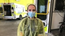 Middlesex-London Paramedic Service Logistics Team Member Larissa Foote wear full PPE gear as she prepares to sanitize an ambulance (Sean Irvine CTV)