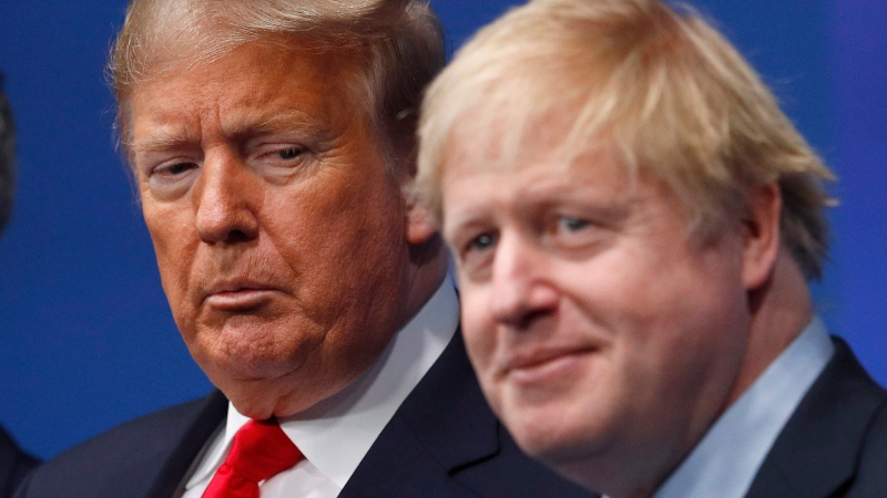 British Prime Minister Boris Johnson, right, and U.S. President Donald Trump pose during a group photo during a NATO leaders meeting at The Grove hotel and resort in Watford, Hertfordshire, England, Dec. 4, 2019. (Peter Nicholls, Pool Photo via AP)