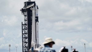 Photographers set up remotes near SpaceX Falcon 9, with Dragon crew capsule on top of the rocket, on Launch Pad 39-A, Friday, May 29, 2020, at the Kennedy Space Center in Cape Canaveral, Fla. (AP Photo/David J. Phillip)