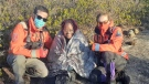 Cecilia Khamete's friend Nenyo poses with volunteers from Halifax Search and Rescue after being lost in the Blue Mountain trail woods for more than six hours. (Photo: Cecilia Khamete)