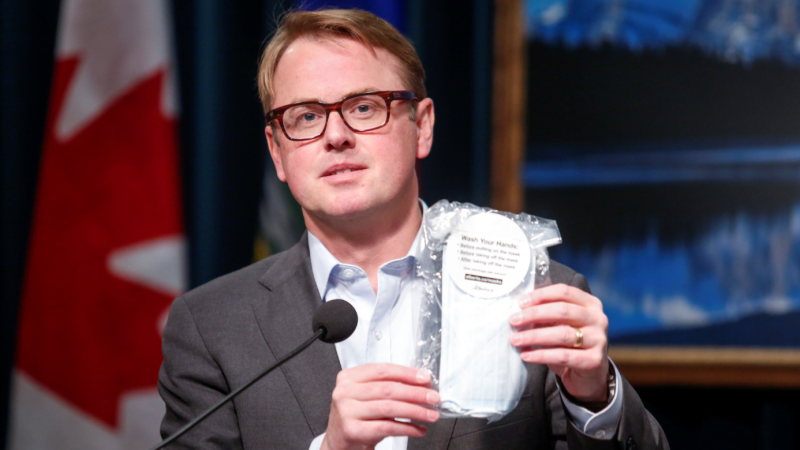 Alberta Minister of Health Tyler Shandro holds a package of four non-medical masks that will be available to Albertans to prevent the spread of COVID-19, in Calgary, Alta., Friday, May 29, 2020. THE CANADIAN PRESS/Jeff McIntosh
