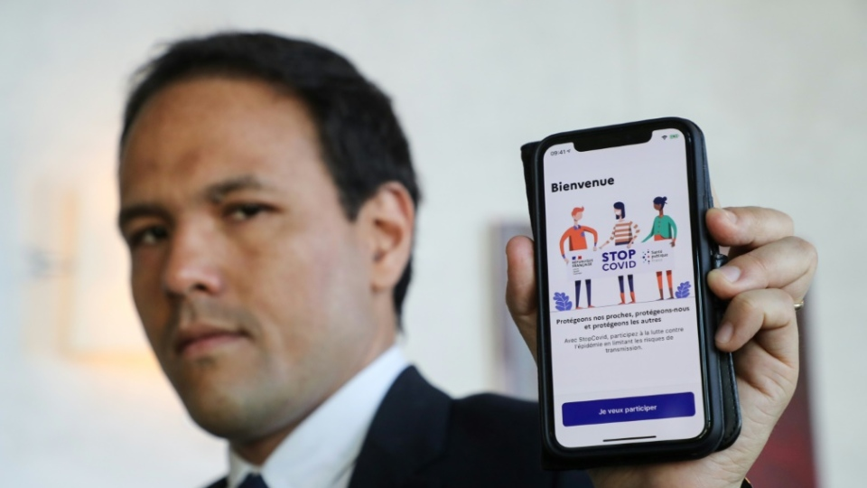 French Junior Minister for the Digital Economy Cedric O presents his country's StopCovid contact tracing app. (AFP)