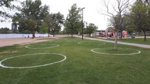 The City of Ottawa has painted physical distancing circles at Mooney's Bay. (Photo courtesy: Twitter/ottawacity)