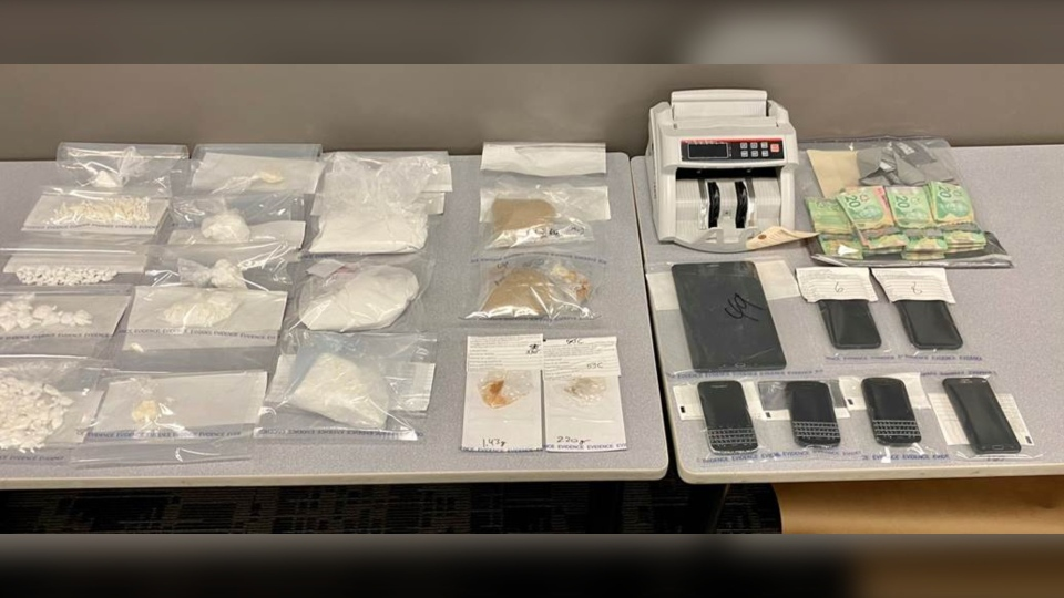 Police seized drugs, cash and paraphernalia at the 900 block of Duchess Street in a recent investigation. (Saskatoon Police Service)