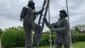 A statue dedicated to Victor Budz and Dennis Guenter.