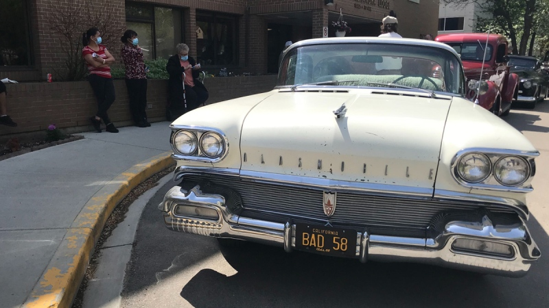 More than 15 classic vehicles drove around the Queen Alexandra Lodge to offer residents a look at some of the rides from their past. May 29, 2020. (Brandon Lynch/CTV News Edmonton)