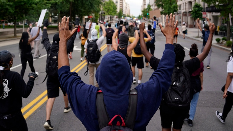 Demonstrators protest the death of George Floyd, a black man who died in police custody in Minneapolis, Friday, May 29, 2020, in Washington. (AP Photo/Evan Vucci)