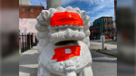 Tape covers racist graffiti on the Chinatown lions statues in Vancouver in a photo posted by the City of Vancouver on May 29, 2020. (Twitter/City of Vancouver)