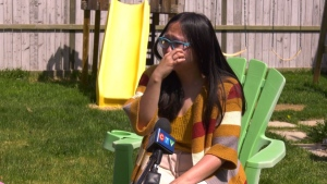 Linda Hoang, a Spruce Grove-based blogger, wipes tears as she describes another setback in her journey to begin a family. She and her husband are clients of Adoption By Choice, a private agency that has recently announced it will close on July 30.