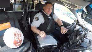 RCMP Constable Cory Kornicki and his friend Wilson on the job. Tuesday May 29, 2020 (CTV News Edmonton)