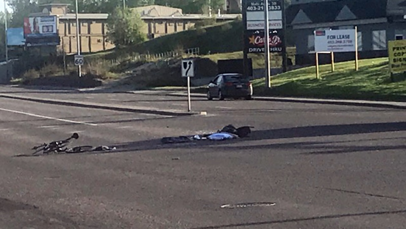 A man is in life threatening condition after being struck by an SUV crossing Macleod Trail Friday evening