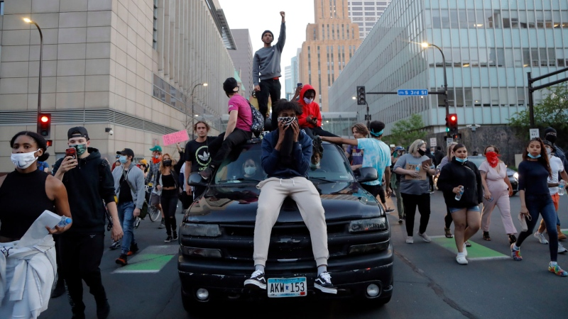 Demonstrators gather Friday, May 29, 2020, in Minneapolis. Protests continued following the death of George Floyd who died after being restrained by Minneapolis police officers on Memorial Day. (AP / Julio Cortez)