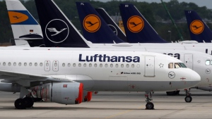 Aircrafts of the German airline Lufthansa are parked at the airport in Munich, Germany, Tuesday, May 26, 2020. (AP Photo/Matthias Schrader)