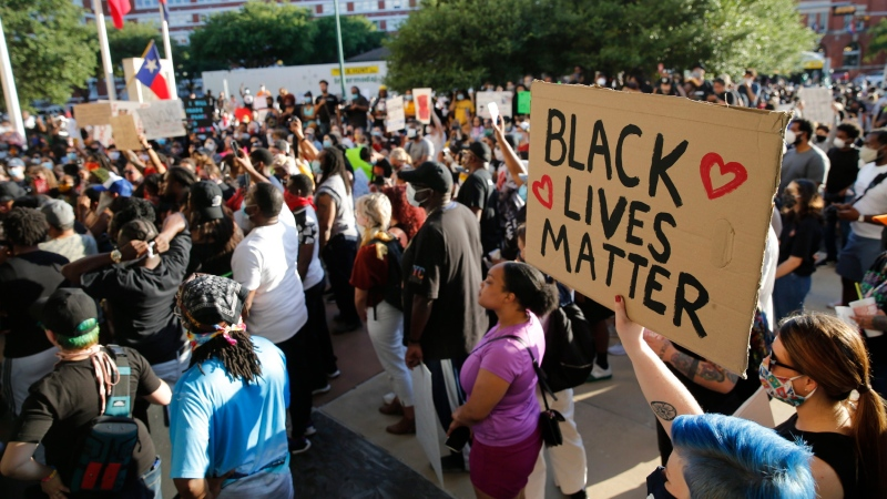 Protesters rally during a demonstration against police brutality in downtown Dallas, on Friday, May 29, 2020. (Vernon Bryant/The Dallas Morning News via AP)