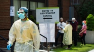 People line up to be tested at a COVID-19 assessment centre in Toronto on Tuesday, May 26, 2020. (Nathan Denette/The Canadian Press)