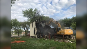 A boarded-up home in the 300 block of Avenue P South is demolished May 29, 2020. (Saskatoon Fire Department)