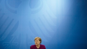 German Chancellor Angela Merkel briefs the media after a meeting of former East German state governors, at the chancellery in Berlin, Germany, Wednesday, May 27, 2020. (AP Photo/Markus Schreiber, Pool)