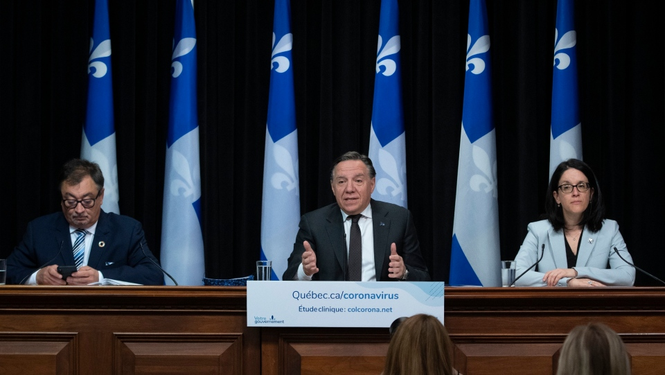 Quebec Premier Francois Legault speaks during a news conference on the COVID-19 pandemic, Thursday, May 28, 2020 at the legislature in Quebec City. Legault is flanked by Horacio Arruda, Quebec director of National Public Health, left, and Quebec Justice Minister and Minister Responsible for Canadian Relations and the Canadian Francophonie Sonia Lebel. THE CANADIAN PRESS/Jacques Boissinot
