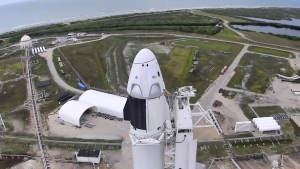 In this image made from video via NASA-TV, a SpaceX Falcon 9, with NASA astronauts Doug Hurley and Bob Behnken in the Dragon crew capsule, prepare to lift off from Pad 39-A at the Kennedy Space Center in Cape Canaveral, Fla., Wednesday, May 27, 2020. The two astronauts are on the SpaceX test flight to the International Space Station. (NASA via AP)